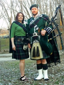 "Benton Mackenzie and wife Loretta in August 2012. Says Loretta via Facebook: ""He loves piping with all his heart and I love to hear him pipe. I don't like to see him down and depressed about his lack of energy and how it effects his piping abilities. He's very talented and I just try to encourage him to pipe whenever the moment strikes him."""